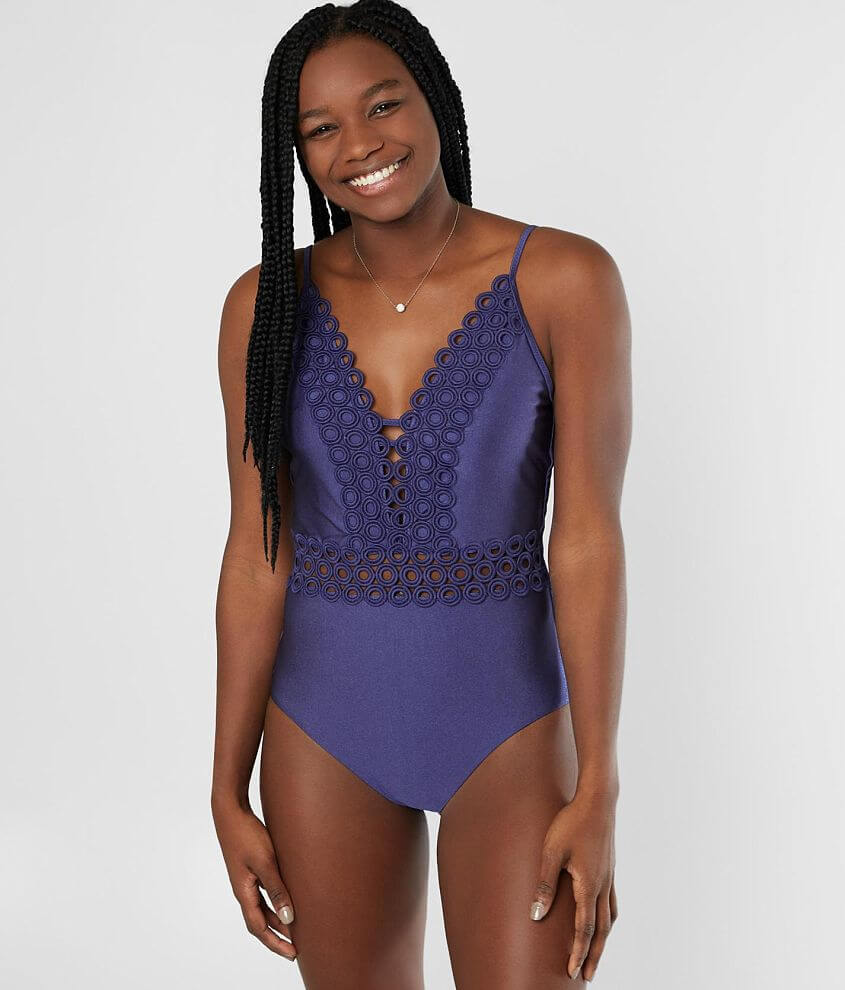 Lined back tie swimsuit Adjustable straps Removable pads Model Info: Height: 5\\\'7\\\