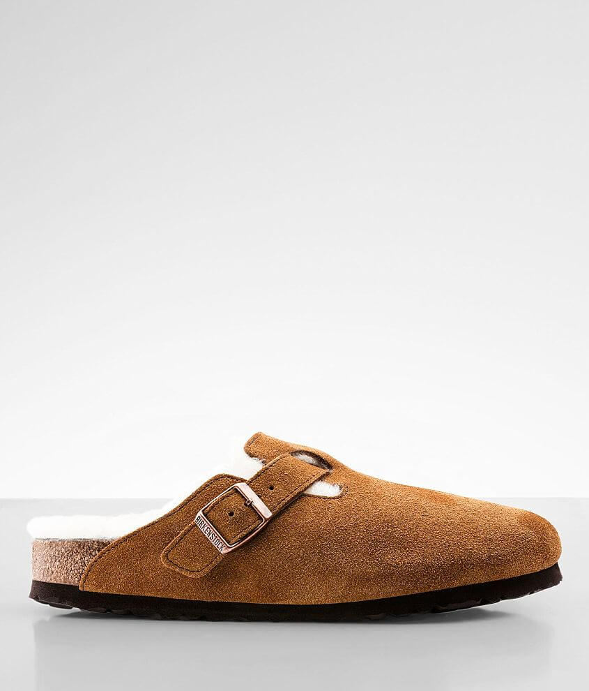 Narrow fit Suede slip-on shoe Genuine shearling fur lining Anatomically shaped footbed Adjustable buckle strap Arch support Shock absorption