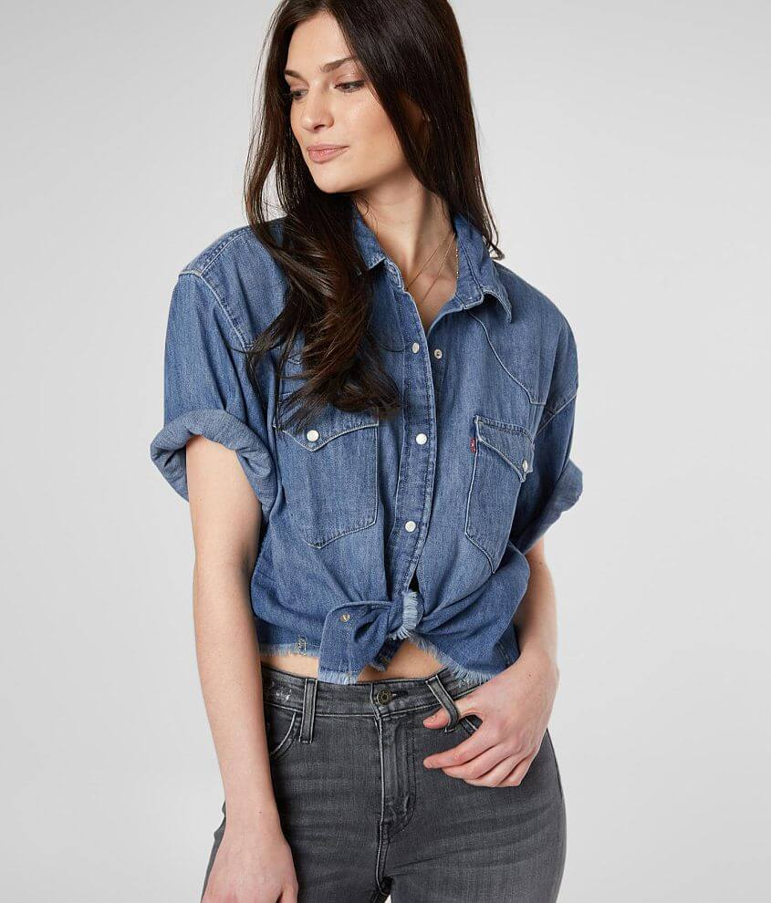 Washed pearl snap front shirt Cuffed sleeves Fraying details Bust measures 40\\\