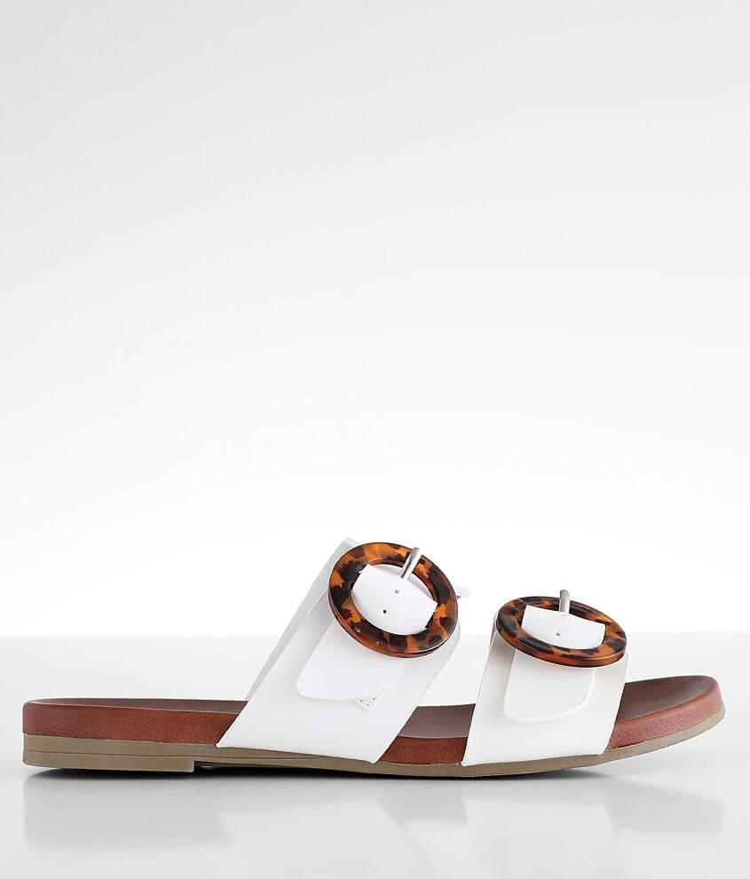 Strappy slip-on sandal Resin ring details Adjustable side straps Cushioned footbed