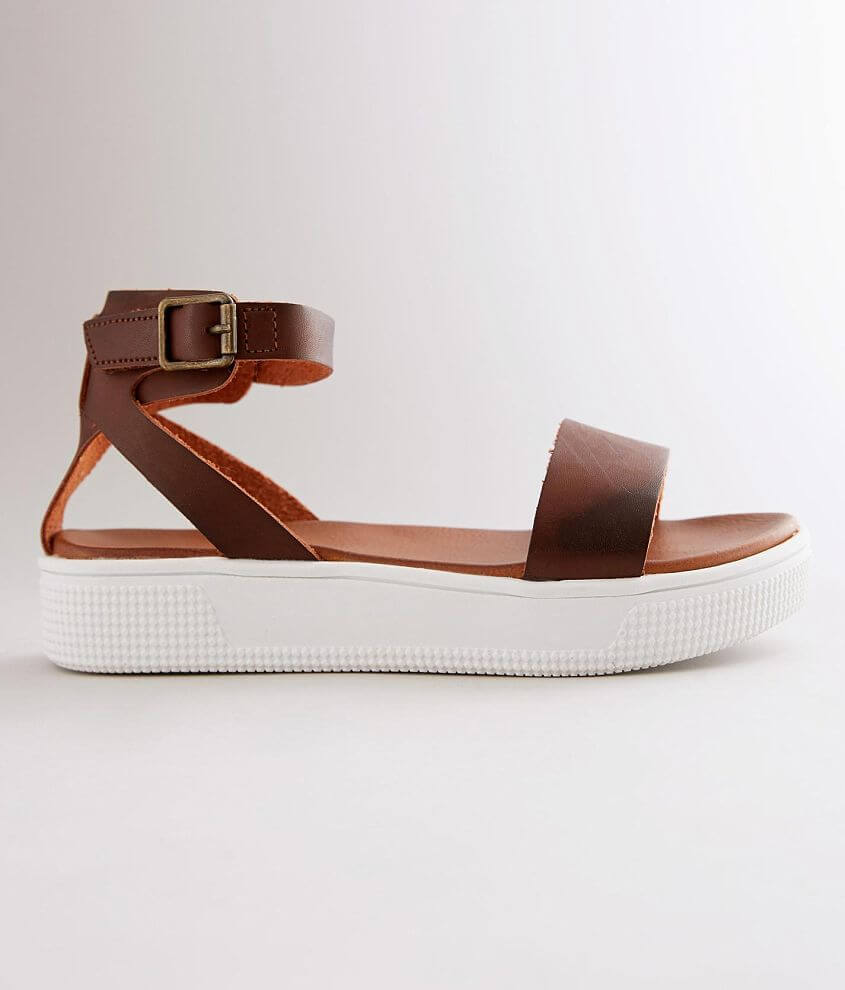 Faux leather sandal Hook and latch ankle strap Cushioned footbed 1 1/8\\\