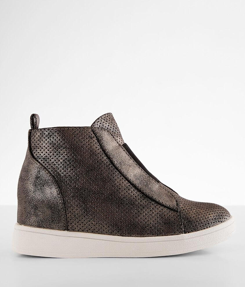 Perforated faux leather shoe Elasticized inset and side zip details Lightly cushioned footbed 2\\\