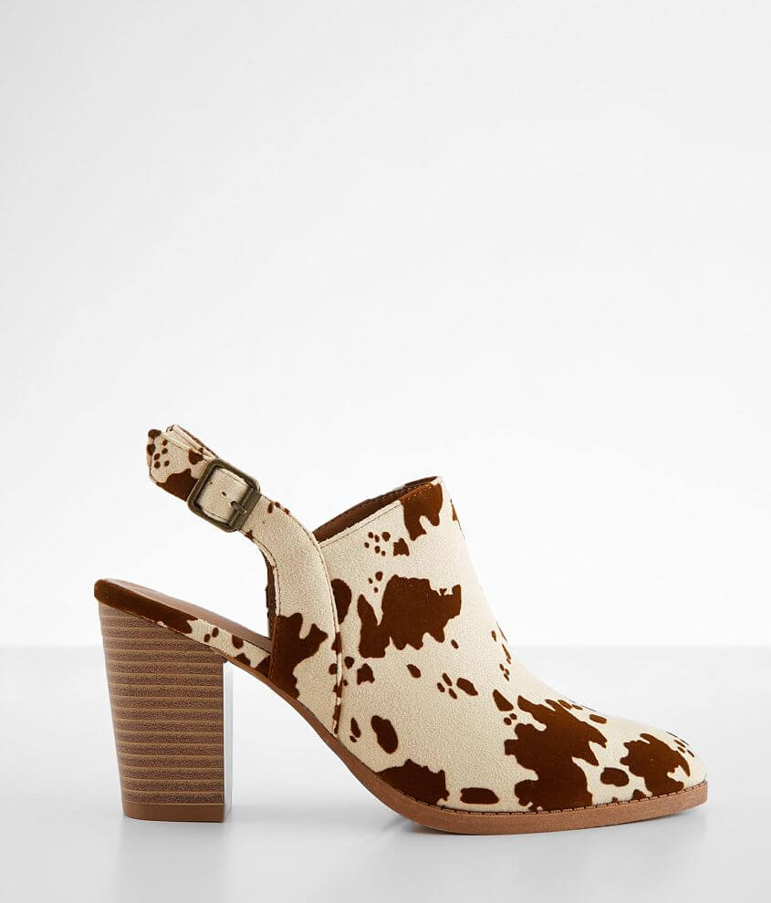 Cow printed faux suede mule Elasticized faux buckle ankle strap Cushioned footbed 3 1/2\\\