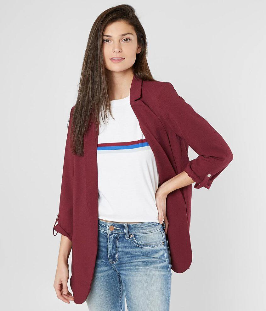 Style R000192BK/Skus 703741, 703742 Solid flyaway lined blazer Faux front pockets Faux convertible button tab sleeves Attached shoulder pads Body length 29 1/2\\\