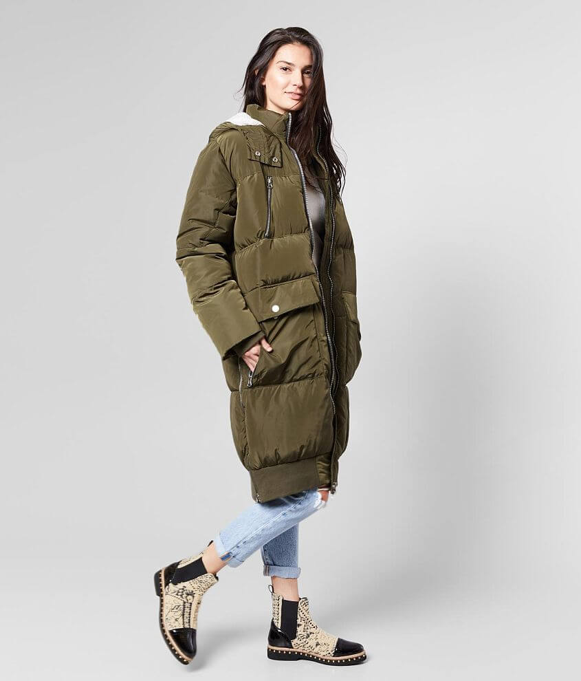 Weather-resistant oversized longline zip front lined coat Sherpa lined hood Front zip and snap pockets Side zip vents Ribbed knit cuffs and hem Bust measures 46\\\