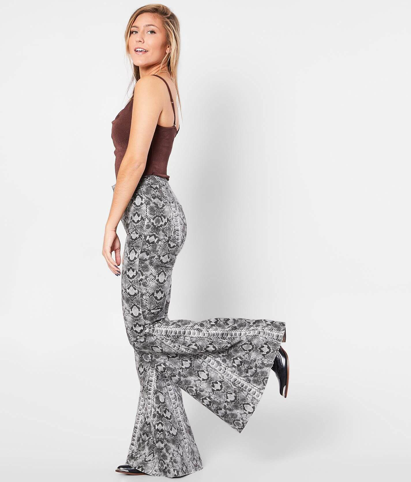Just Float On Snake Print Flare Jean by Free People