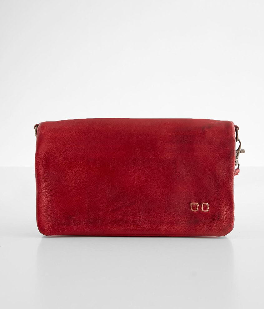 Distressed leather lined purse Foldover magnetic snap closure Multiple interior compartments Removable shoulder and wristlet straps Dimensions: 8\\\