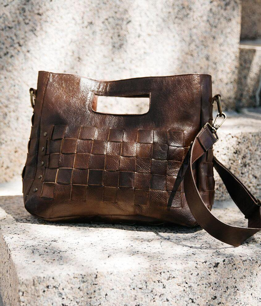 Distressed leather weaved crossbody purse Zipper closure Interior zipper and two pouch pockets Removable shoulder strap Dimensions: 13\\\
