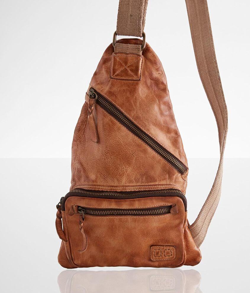 Distressed leather lined backpack Zipper closure Interior zipper and pouch pockets Adjustable shoulder strap Dimensions: 8 1/2\\\