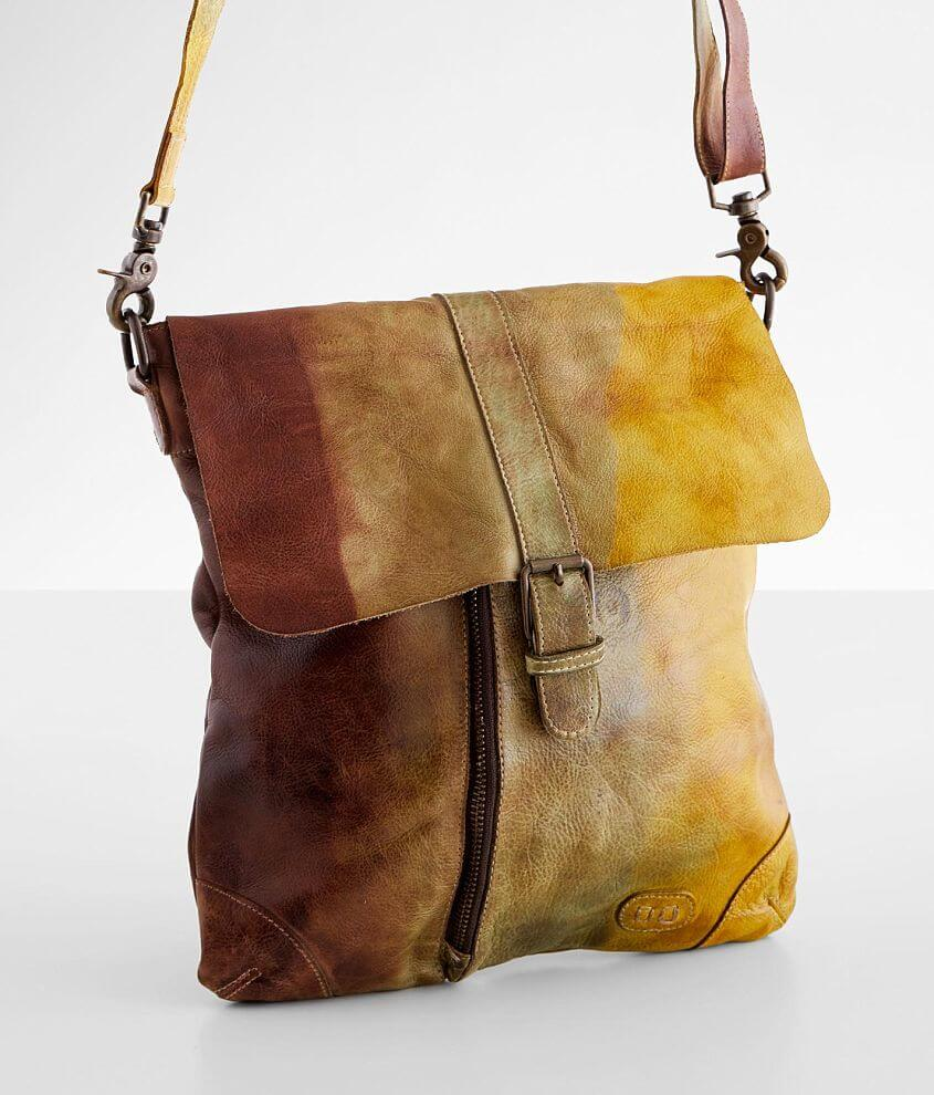 Distressed tie dye canvas lined purse Foldover magnetic snap and zipper closures Interior zipper and two pouch pockets Removable shoulder strap Dimensions: 11\\\